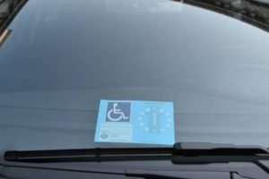 car with parking permit for disabled people