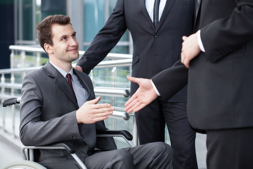 disabled worker with colleagues